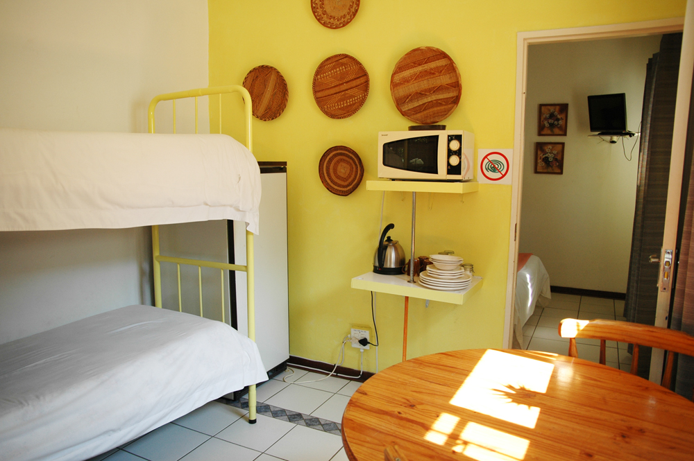 Elephant Walk Guest House yellow room