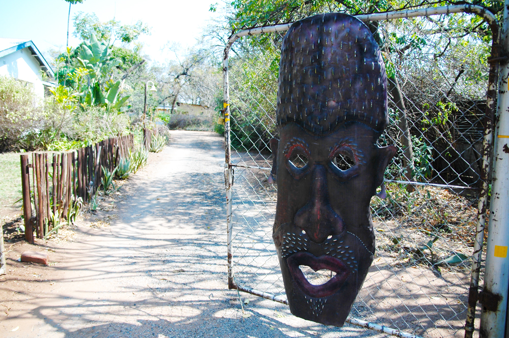 Elephant Walk Backpackers & Guest House African Mask on Gate
